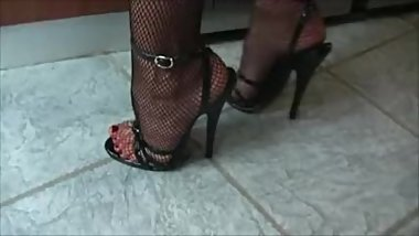 Mature Is Cleaning The Counter In Black Fishnet Pantyhose