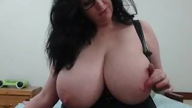 Busty webcam milf plays with tits