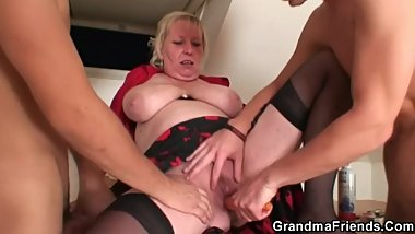 Old blonde spreads legs for two cocks