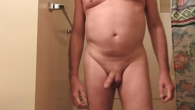 Naked mature man taking shower, then playing with his cock.