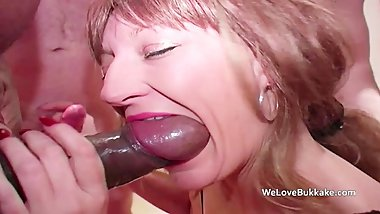 Mature sucks huge thick black cock and others and gets face coated in semen