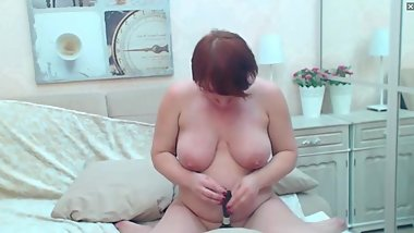 Mature webcam model strip and tickles herself and your dick