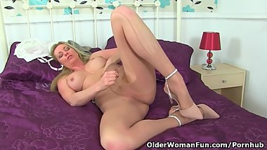 English milf Holly Kiss feels horny in tan tights