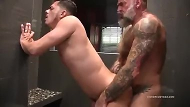 Muscular silver daddy fucks a hot young powerbottom in the shower