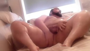 Chubby bear applies lotion to his whole naked body on webcam