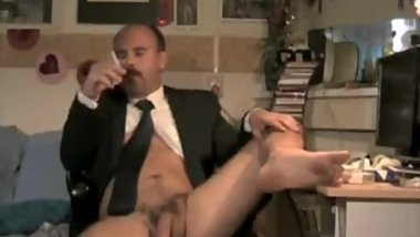 suited mustached daddy smokes and cums masturbating on webcam barefoot
