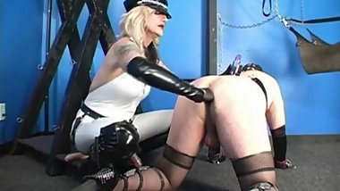 Mature blonde Domme has a sissy in lingerie on all fours to train his ass