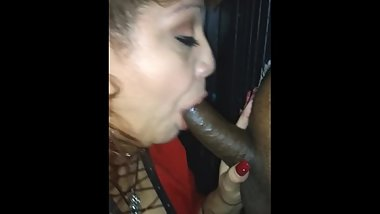 Rae Lynn sucking a BBC through a glory hole