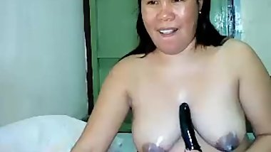 filipina mature lynn showing her big tits and playing with dildo on cam