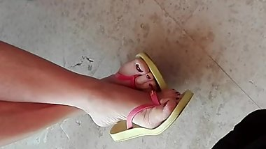 Naked Female Feet in yellow-pink Flip Flops 2